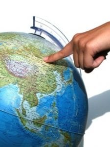 Hand pointing at globe