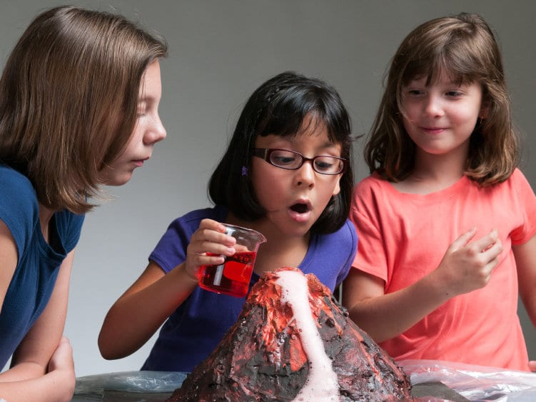 Photo of Children Classroom Science Experiment: How Population Education Helps Students Read and Write like Scientists