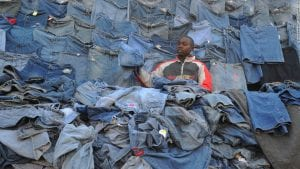 A clothing seller in Kenya resells imported jeans.