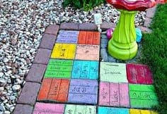 Painted recycled bricks create yard art
