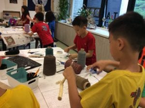 Young students building data sculptures