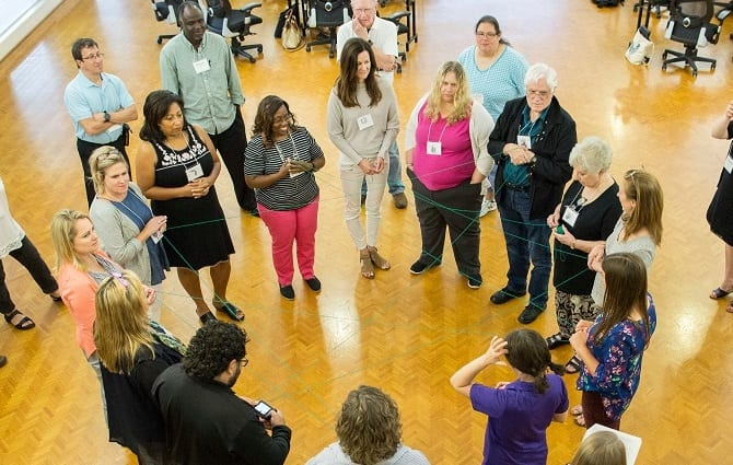 """PopEd staff lead educators through the lesson """"Web of Life"""""""