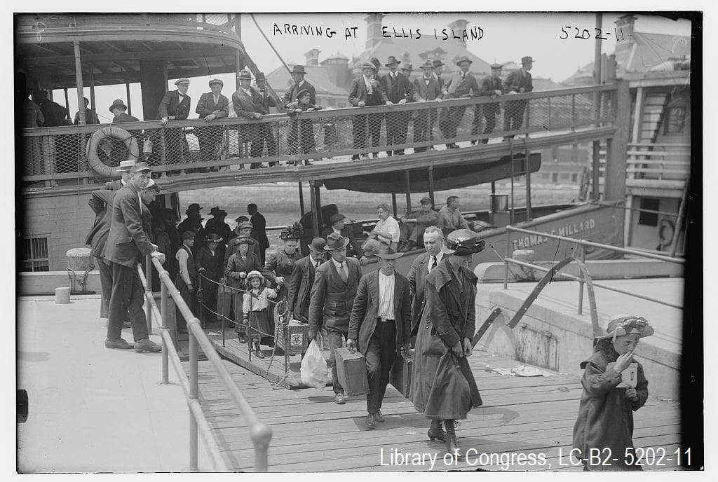 Photograph of immigrants arriving to Ellis Island, circa 1915