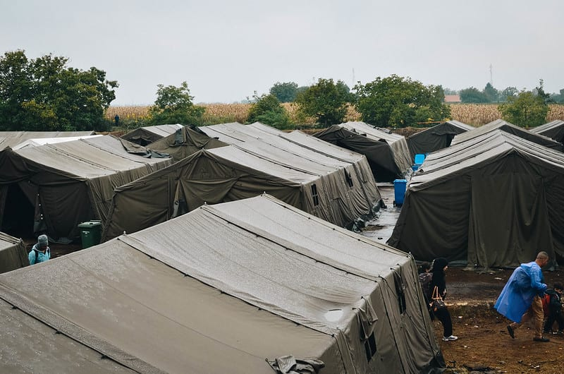 Large tents make up a refugee camp