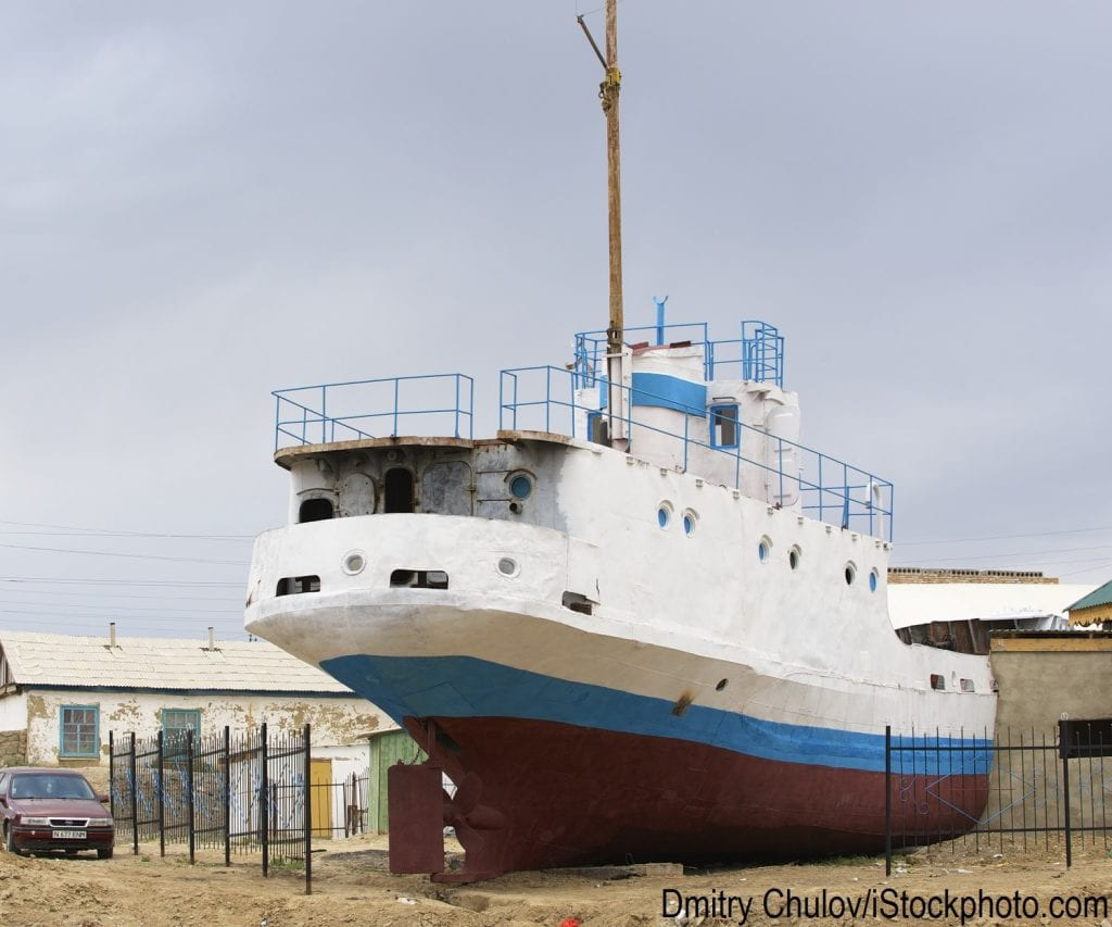 A fishing boat in Aralsk, Kazakhstan remains on shore after no longer being proximate to the evaporating Aral Sea.