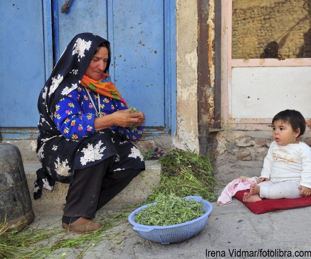 A woman with her grandchildren in Iran.