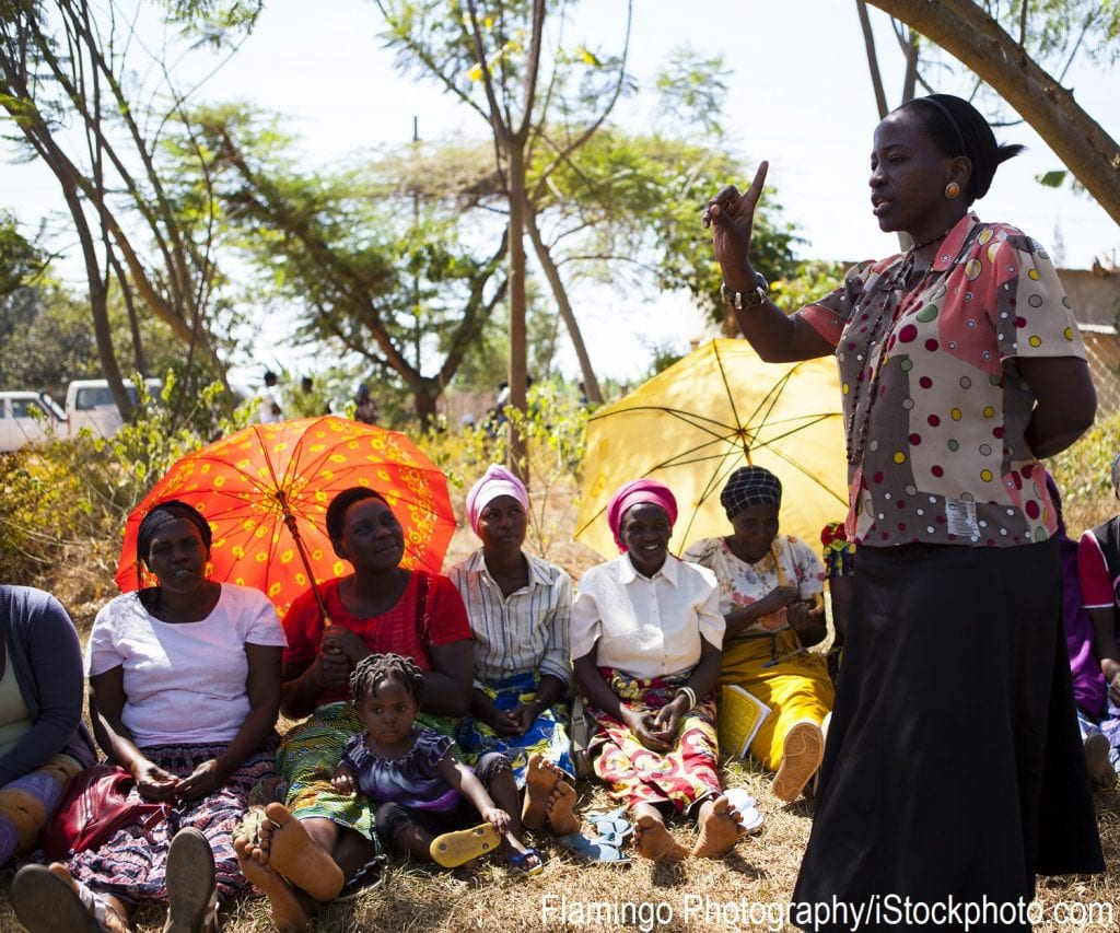 A woman in Kigali, Rwanda speaking to other women and girls.