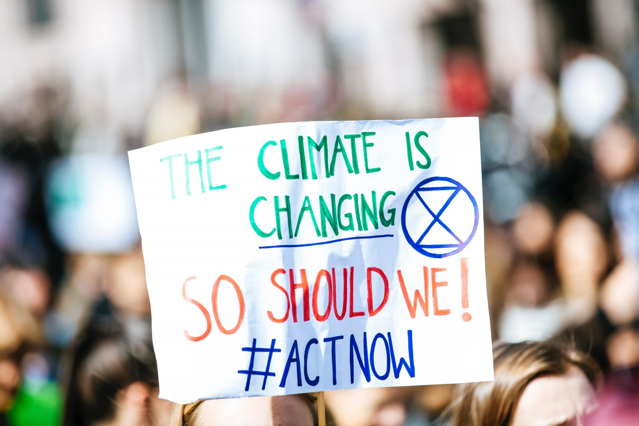 Climate action rally sign act now