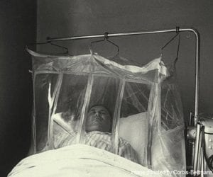 Patient resting in an oxygen tent due to air pollution in Denora, PA, 1948