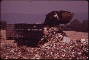 The Croton Landfill Operation 08/1973 - A trash truck dumping garbage