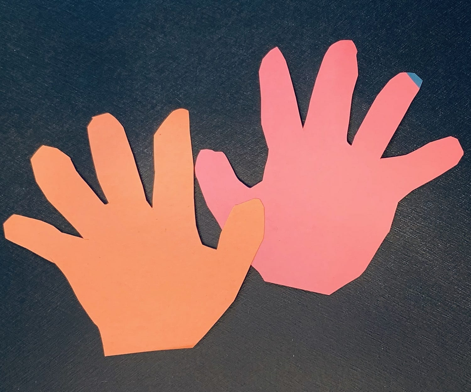 Child's hand print cut out of construction paper for the Earth Day lesson, Lend a Hand to the Earth