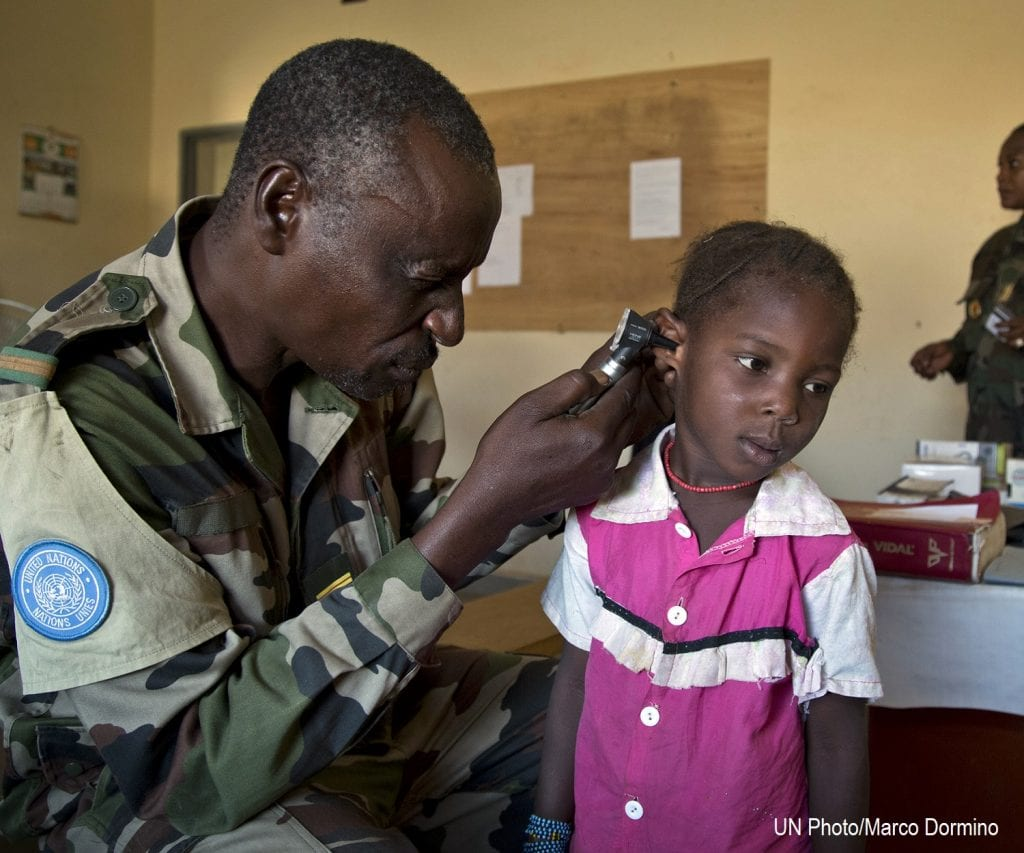 Young child at a health clinic getting a check up