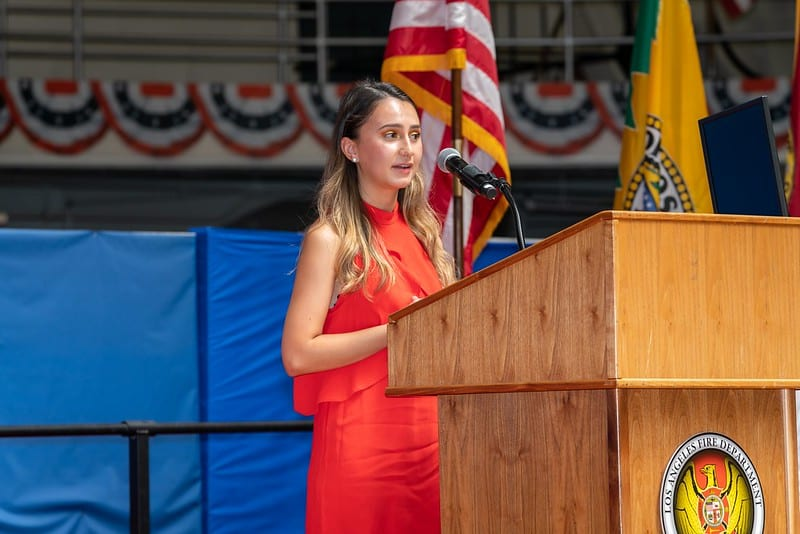 High school student public speaking at podium