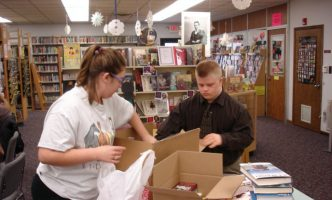 Student volunteers packing books