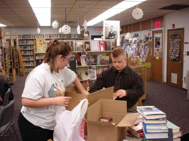 Student volunteers packing books