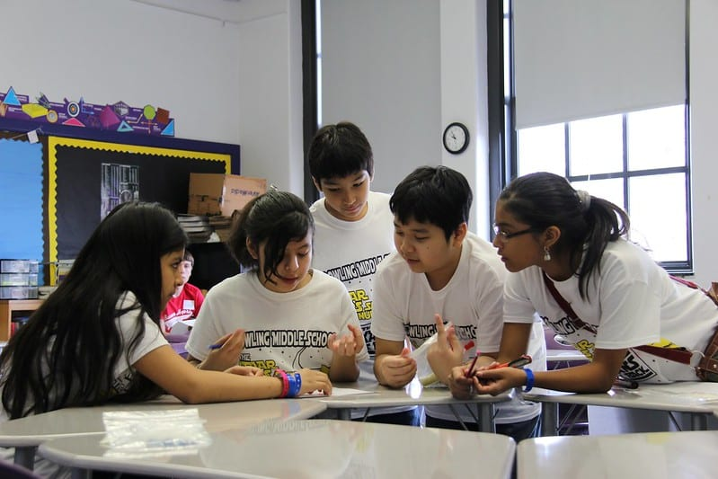 Young teens working together in middle school classroom
