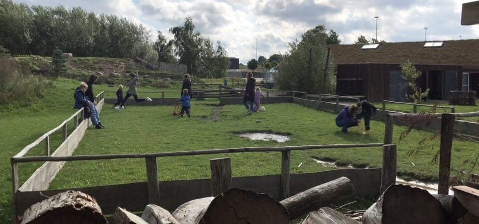 Slagelse, Denmark - Young children at Skovbørnehuset explore outdoor play area made of wood and other organic materials
