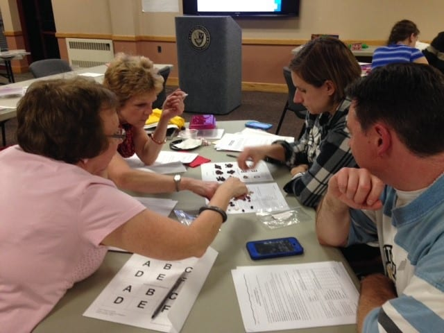 Teachers model biodiversity loss in temperate and tropical forests during a professional development workshop.