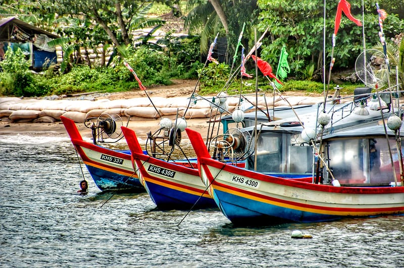 Multicolored (red, white, yellow and blue) traditional fisherman boats in Langkawi, Malaysia