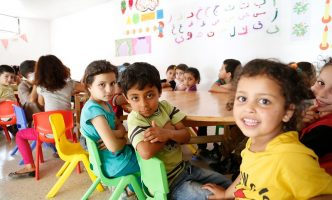 Syrian primary school children attend catch-up learning classes in Lebanon